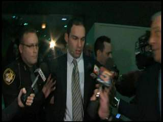 Reaction in hallway of courthouse after trial
