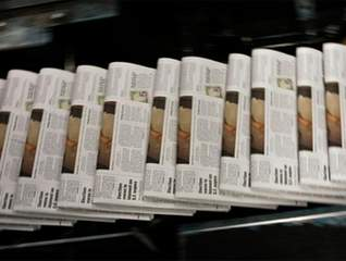 Newspaper revenue fell 2 pct to $38.6B in 2012