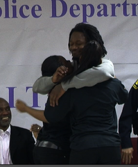 Adam Jones hugs boot camp graduates