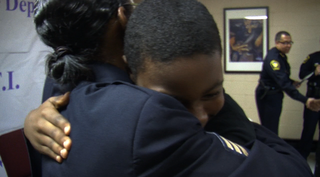 Cincinnati Police officer congratulates Rothenberg student