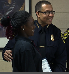 Chief Craig congratulates student graduating boot camp
