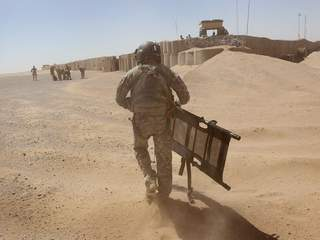 Army soldier carries stretcher to injured Marine_20120516170442_JPG