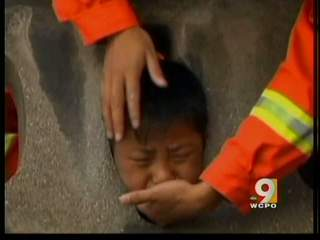 Boy gets head stuck in guardrail