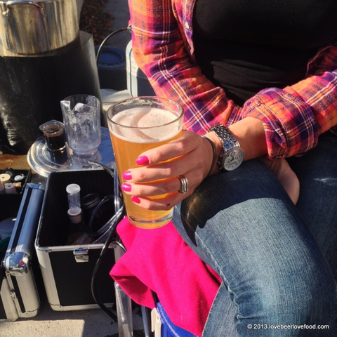 a girl with a beer