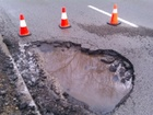 Get reimbursed for pothole, road debris damage