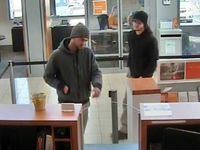 Two PNC Bank robbery suspects at large