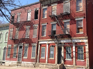 City takes aim at owner as OTR buildings crumble