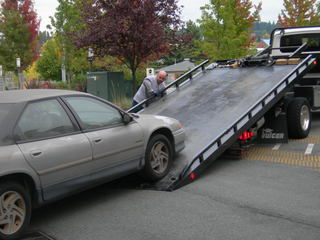 Tow truck damages your car: Who pays?