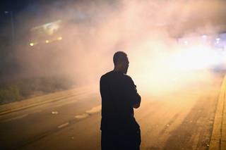 Ferguson protest turns into clash with police