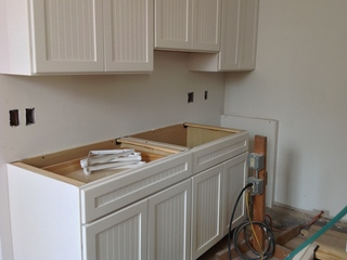 Mystery: Where did woman's kitchen cabinets go?