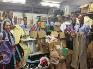 Firefighter recruits donate supplies to students