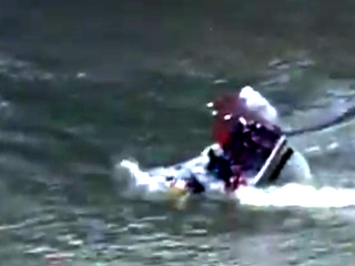 VIDEO: Rescue boat capsizes in search for boy