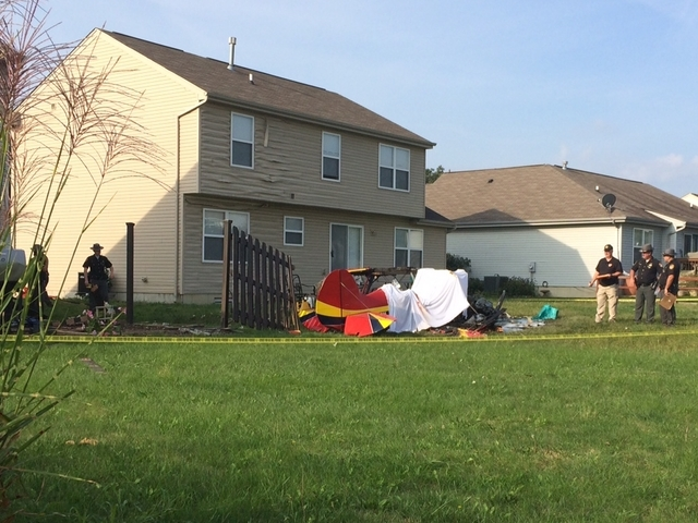 Airplane crashes into house in Liberty Township