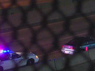Car strikes police cruiser on I-75
