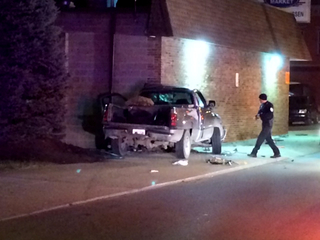 Pickup crashes into building in Dayton