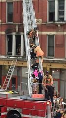 8 children among 10 rescued from burning OTR apt