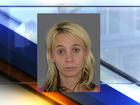 PD: Woman assisted robbery with child in car