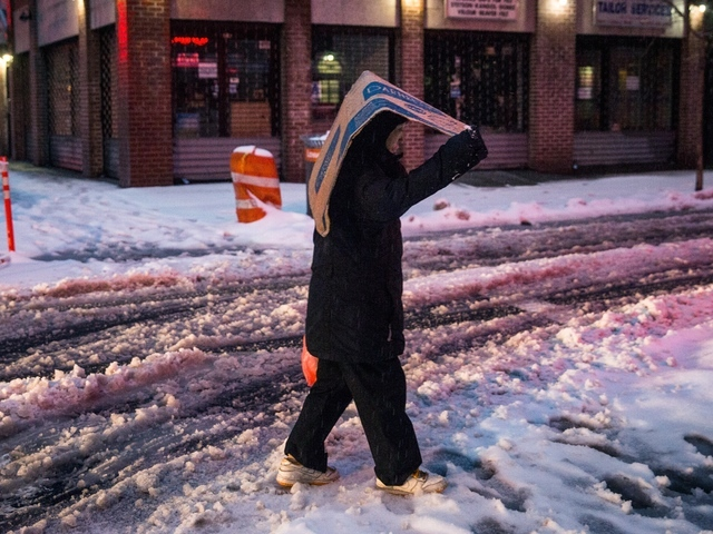 Freezing rain and flooding today, snow Wednesday