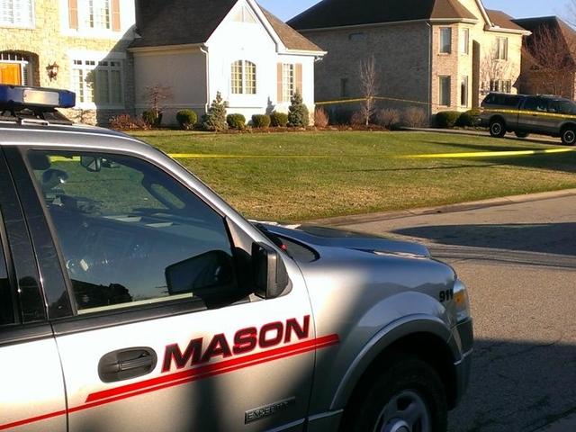 Man in custody claims he wrestled gun from wife