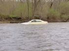 Does car lodged in river create driving danger?