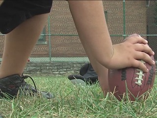 Amid spike in shootings, football gives focus