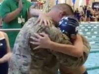 Dad surprises son at swim meet after deployment