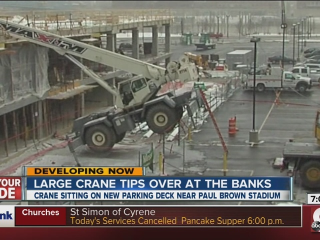 Closeup reveals damage to tipped-over crane at The Banks