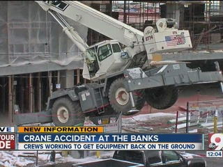 Crane accident puzzles crews at The Banks