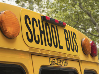 School bus rolled in crash, injuries reported