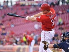 Reds beat Brewers 9-5 in spite of bullpen