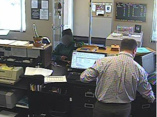Police say man gave girl a gun for bank robbery