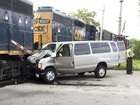 Woman charged in deadly train-van crash