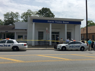 PD: Officer kills man during bank robbery