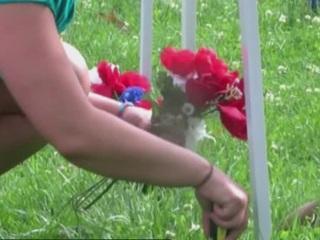 Volunteer to decorate a homeless veteran's plot
