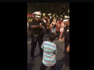 CPD officer takes boy's dance-off challenge
