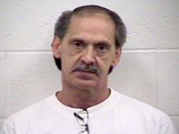 PD: Man walks to station, says he killed ex-wife