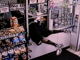 VIDEO: Robber flees with entire cash register