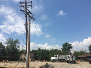 Downed power lines trap motorists on Five Mile