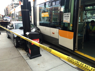 Car collides with Cincinnati streetcar Downtown