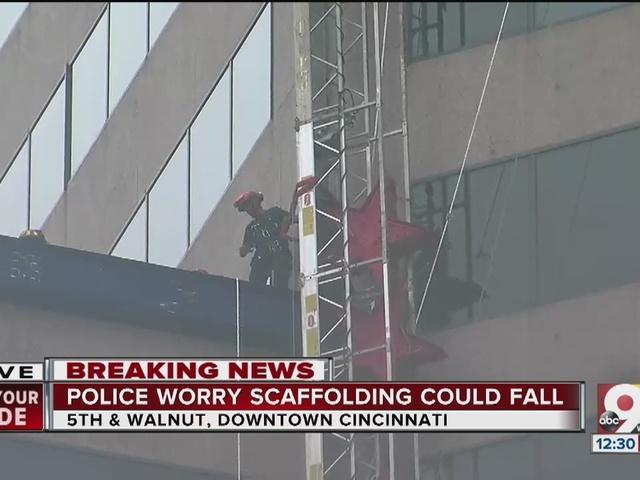 Window-washing platform dangles sideways off US Bank building in…