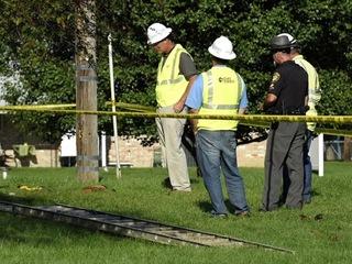 2 hurt when equipment hits power lines at church
