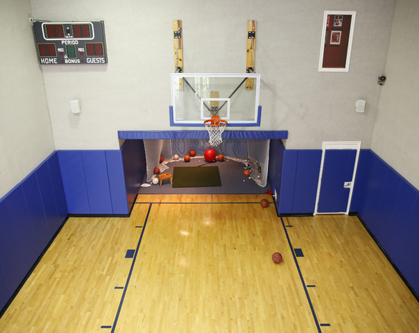 Home tour this edgewood house was built for fun and games for Built in basketball court