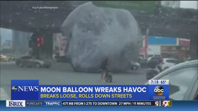 Giant Moon Terrorizes China's Streets, Rolls Over Cars and People