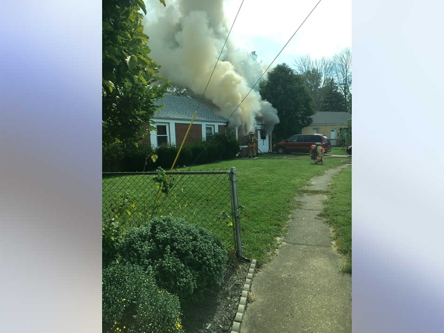 Crews fight a fire in Manitowoc County
