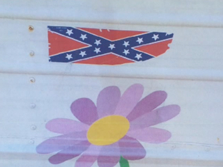 Confederate flag sticker placed on day care bus