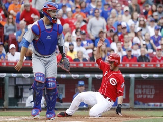 Reds pull away a 7-4 victory over Cubs