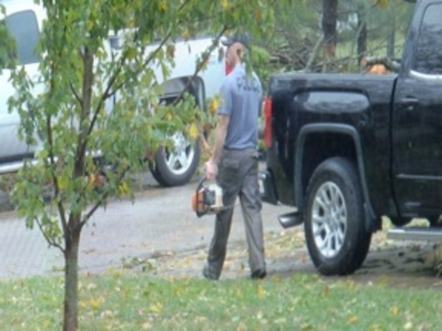 Officers clean up elderly man's yard after storm