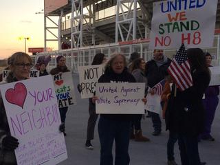 Anti-Trump demonstrators march outside speech