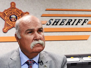This sheriff stands alone in Ohio, Ky., Ind.