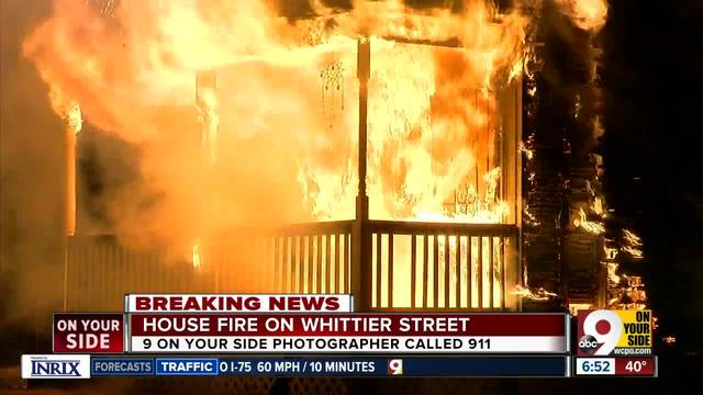WATCH- News photographer finds vacant building fire- calls 911